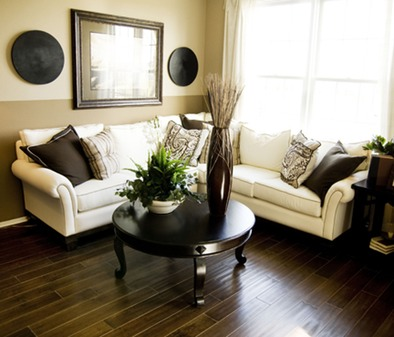 A Formal Living Room With Wood Flooring In A Dark Finish